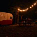 retro camper campsite at night