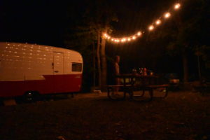 retro camper campsite at night