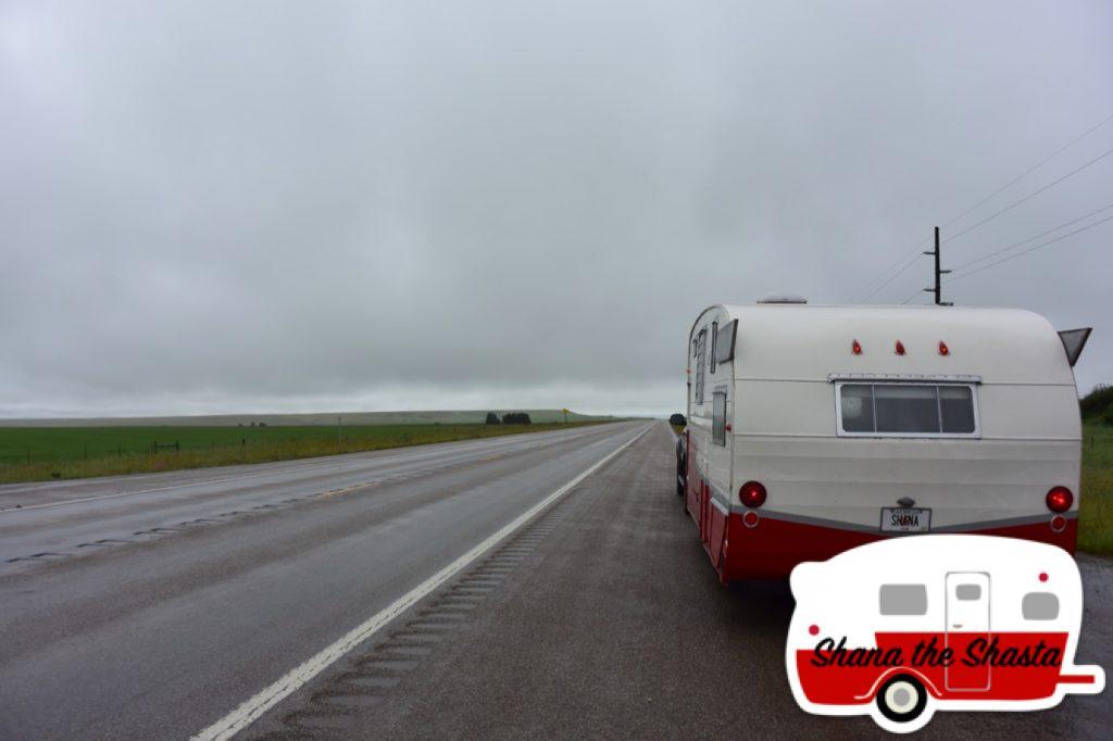 Retro-Camper-on-Rainy-Road-Montana